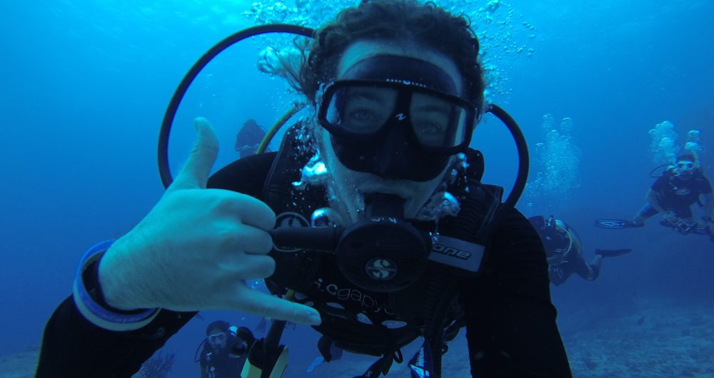 backpacker scuba diving