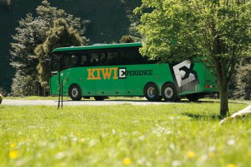 kiwi experience bus pass hop on hop off new zealand backpacker